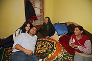 Razvan in his bedroom surrounded by his grand-mothers and his cousin