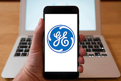 Using iPhone smartphone to display logo of GE, General Electric
