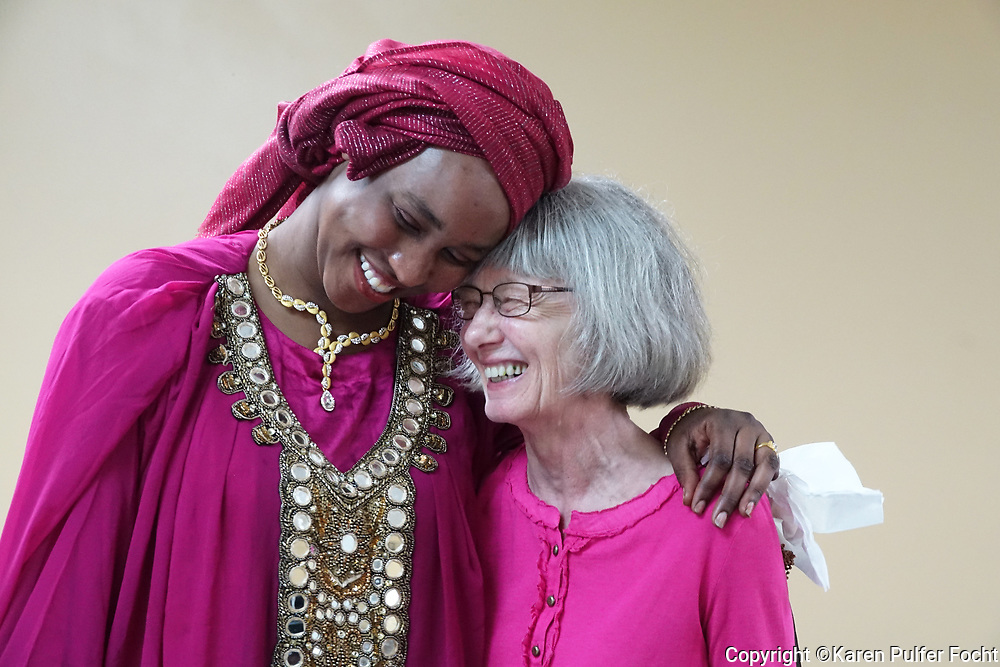 Gesma Mohammed and Brigitte Schmidt became fast friends during a luncheon to celebrate World Refugee Day at Catholic Charities in Memphis. The luncheon took place on Thursday,  a day after the actual celebrated day. Community members were put  at tables together during the luncheon so that community members and refugees could become acquainted. Mohammed, who is taking naturalization classes at Catholic Charities is from Sudan, Schmidt is from Memphis.  © Karen Pulfer Focht