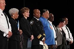Newly-appointed Minneapolis Police Chief Medaria Arradondo, middle, stands between Clyde Bellecourt and Mayor Betsy Hodges during a public swearing-in ceremony for Arradondo on Friday, Sept. 8, 2017, at the Sabathani Community Center in Minneapolis. (Photo by Anthony Souffle/Minneapolis Star Tribune/TNS/Sipa USA)