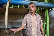 Fondy (51 years) is a contracter working for PT Timah, his mine produces 60 tons of tin a month. He hopes to be able to produce 80-100 tons next year. The Pemali mine,  the biggest legal mine in Bangka that has completely devastated the once green landscape. Operated by PT-Timah. It produces 60 tons of tin per month. Bangka Island (Indonesia) is devastated by illegal tin mines. The demand for tin has increased due to its use in smart phones and tablets.<br /> <br /> <br /> Fondy (51 ans) est un sous-traitant, travaillant pour PT Timah, sa mine produit 60 tonnes d'étain par mois, il espère atteindre 80-100 tonnes l'année prochaine. Mine de Pemali, plus grande mine légale de Bangka. Exploité par PT-Timah. Elle produit 60 tonnes d'étain par mois.  L'île de Bangka (Indonésie) est dévastée par des mines d'étain. La demande de l'étain a explosé à cause de son utilisation dans les smartphones et tablettes.
