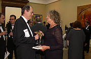 Richard Cork and Germaine Greer, Royal Academy summer exhibition annual dinner. Picadilly.  2 June 2004. ONE TIME USE ONLY - DO NOT ARCHIVE  © Copyright Photograph by Dafydd Jones 66 Stockwell Park Rd. London SW9 0DA Tel 020 7733 0108 www.dafjones.com