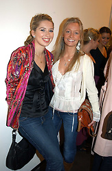 Left to right, ALEX FINLAY and MARTHA WARD at an exhibition of photographs by Matthew Mellon entitled Famous Feet - featuring well known people wearing shoes from Harrys of London, held at Hamiltons Gallery, Carlos Place, London on 22nd November 2004.<br /><br />NON EXCLUSIVE - WORLD RIGHTS