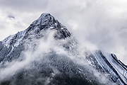 A snow-dusted peak in the Queen Elizabeth Ranges in Maligne Valley, Jasper National Park, Canadian Rockies, Alberta, Canada. Jasper is the largest national park in the Canadian Rocky Mountain Parks World Heritage Site declared by UNESCO in 1984.