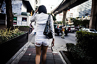 A transgendered woman walks along Sukhumvit Road near Nana Plaza in Bangkok, Thailand.