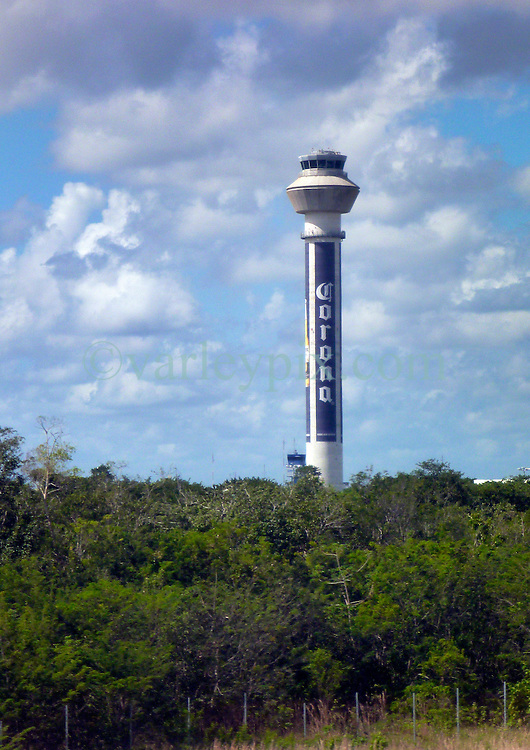 06 Feb 2014. Cancun International Airport, Mexico.<br /> Welcome. The control tower is a giant Corona.<br /> Photo; Charlie Varley/varleypix.com