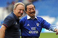 Cardiff City manager Neil Warnock (l) celebrates going top of the league after a 3-0 victory over Aston Villa with Cardiff city club owner Vincent Tan ® who is making a rare visit to his Welsh club. . EFL Skybet championship match, Cardiff city v Aston Villa at the Cardiff City Stadium in Cardiff, South Wales on Saturday 12th August 2017.<br /> pic by Carl Robertson, Andrew Orchard sports photography.
