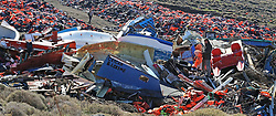 Embargoed to 0001 Monday February 6 British expatriate Eric Kempson (right), who is battling to save lives on the Greek island of Lesbos, stands between smashed migrant boats and piles of used life jackets, which he said the majority of which are fake and include at least 150,000 vests, half of the original amount that began to accumulate after long trips to the main tip became unsustainable owing to the large influx of refugees and subsequent discarded life jackets, located on the island close to his home in Eftalou, where the 61-year-old warned the refugee crisis is far from over.