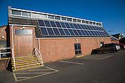 Rooftop array solar panels on community centre building, Woodbridge, Suffolk, England