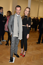 ROBERT SHEFFIELD and CHLOE FLEMING at the opening private view of 'A Strong Sweet Smell of Incense - A portrait of Robert Fraser, held at the Pace Gallery, Burlington Gardens, London on 5th February 2015.