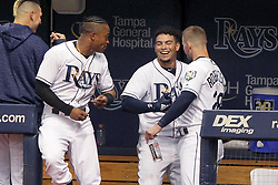 May 22, 2018 - St. Petersburg, FL, U.S. - ST. PETERSBURG, FL - MAY 22: Mallex Smith (0), Willy Adames (1) and Daniel Robertson (28) of the Rays all celebrate Willy Adames' home run during the MLB regular season game between the Boston Red Sox and the Tampa Bay Rays on May 22, 2018, at Tropicana Field in St. Petersburg, FL. (Photo by Cliff Welch/Icon Sportswire) (Credit Image: © Cliff Welch/Icon SMI via ZUMA Press)