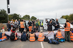 Angry motorists contest Insulate Britain climate activists blocking a slip road from the M25 at Junction 25 as part of a campaign intended to push the UK government to make significant legislative change to start lowering emissions on 15th September 2021 in Enfield, United Kingdom. The activists, who wrote to Prime Minister Boris Johnson on 13th August, are demanding that the government immediately promises both to fully fund and ensure the insulation of all social housing in Britain by 2025 and to produce within four months a legally binding national plan to fully fund and ensure the full low-energy and low-carbon whole-house retrofit, with no externalised costs, of all homes in Britain by 2030 as part of a just transition to full decarbonisation of all parts of society and the economy.