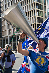 London, UK. 30th April 2019. Steve Bray of SODEM (Stand of Defiance European Movement) uses a loud hailer as he protests outside the Labour Party HQ where an NEC meeting was taking place to confirm plans for Labour's EU election manifesto, including its stance with regard to a second referendum.