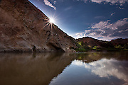 Sunburst and morning reflections on the Green River at Split Mountain, Dinosaur National Monument, Utah