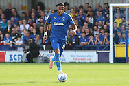 AFC Wimbledon midfielder Liam Trotter (14) dribbling during the EFL Sky Bet League 1 match between AFC Wimbledon and Portsmouth at the Cherry Red Records Stadium, Kingston, England on 13 October 2018.