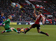 Jack O'Connell of Sheffield Utd has a shot saved by Connor Ripley of Oldham during the English League One match at Bramall Lane Stadium, Sheffield. Picture date: December 26th, 2016. Pic Simon Bellis/Sportimage