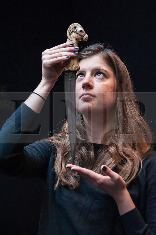 © Licensed to London News Pictures. 02/10/2015. London, UK. A Sotheby's employee shows a knife decorated with an elaborate ivory handle carved with a ram's head at the preview of Indian and Islamic Art Week at Sotheby's which runs from 2 to 7 October.  Photo credit : Stephen Chung/LNP