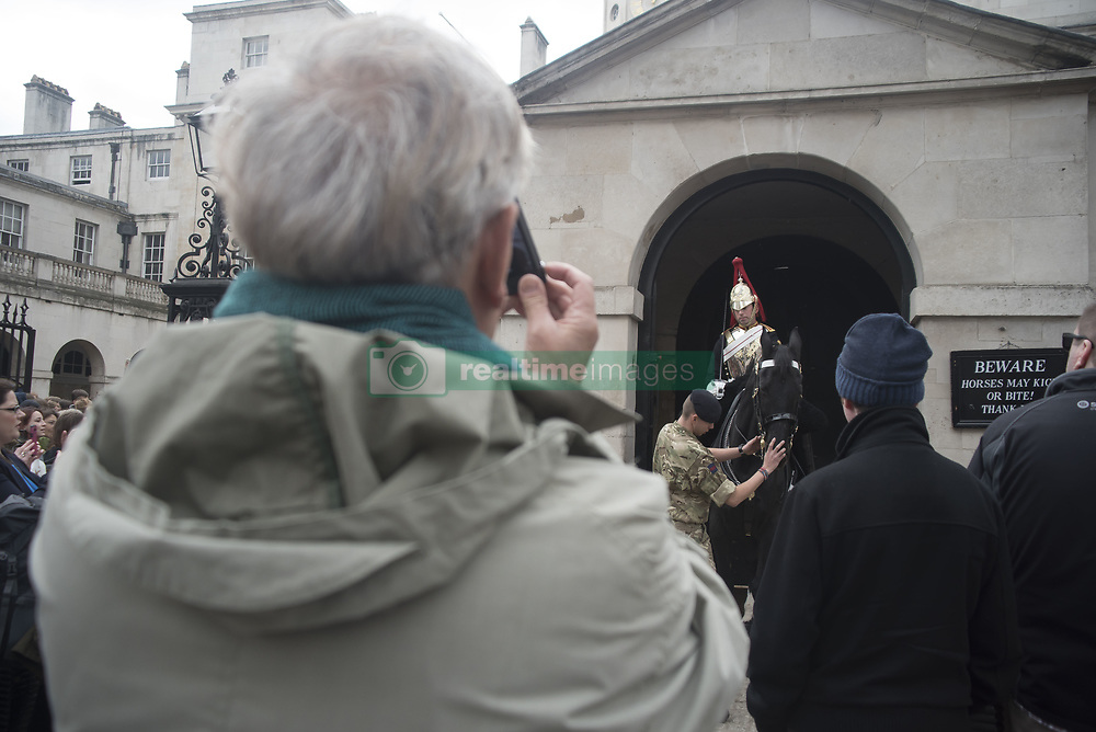 April 27, 2017 - London, Greater london, United Kingdom - The Queen's life guards are pictured at the Horse Guards Parade while on duty. Several tourists stop to see them and take pictures. (Credit Image: © Alberto Pezzali/Pacific Press via ZUMA Wire)