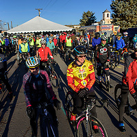 Competitors line up on bicycles before the start of the 2018 Mount Taylor Quadrathlon in Grants Saturday.