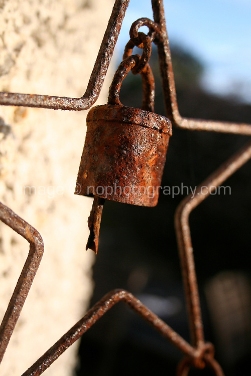 Rusting bell chimes hanging on garden wall outside in Ireland