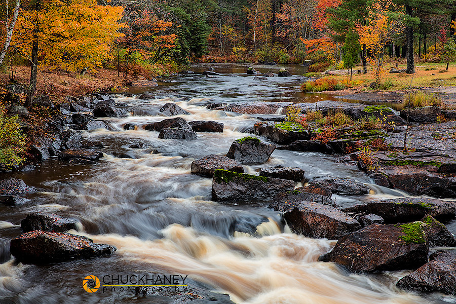 The Middle Branch of the Escanaba River Rapids in autumn near Palmer, Michigan USA