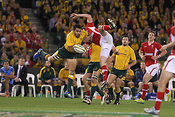 © Licensed to London News Pictures. 16/06/2012. Etihad Stadium, Melbourne Australia. Digby Ioane clashes with a Welsh player going up for a high ball during the 2nd Rugby Test between Australia Wallabies Vs Wales . Photo credit : Asanka Brendon Ratnayake/LNP