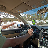 A driver shows his pass to a park ranger at the Tioga Pass entrance station to California's Yosemite National Park.