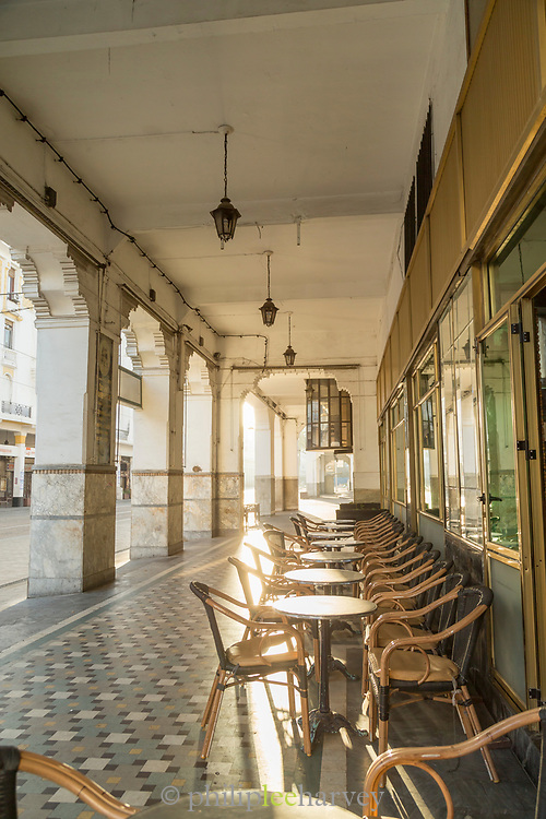 Tables lined up on colored tile floor in front of Le Petit Poucet restaurant, Casablanca, Morocco