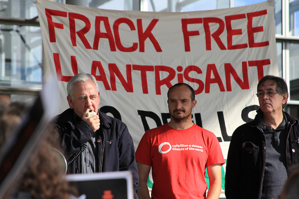 Lord Dafydd Wigley speaks at an anti-fracking rally outside Y Senedd, Cardiff. Next to him is Gareth Clubb of Friends of the Earth Cymru and Assembly Member Mick Antoniw