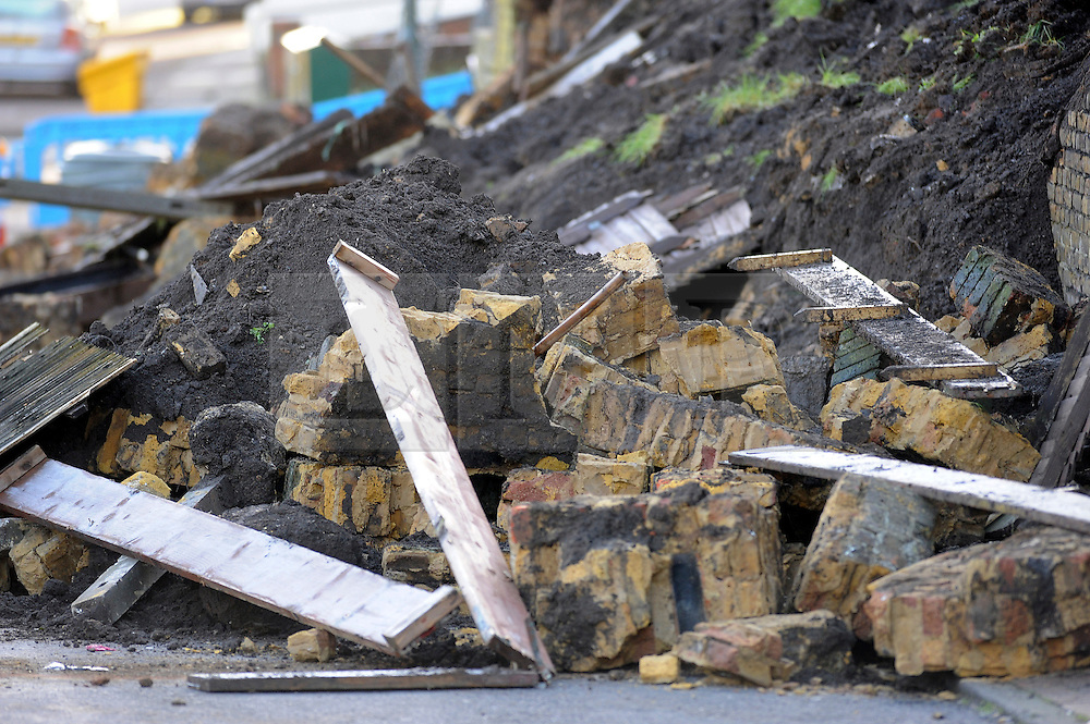 © Licensed to London News Pictures. 08/01/2016. Chatham, UK. The scene where a 40ft long wall has collapsed next to Magpie Community Centre Chatham, Kent, crushing a number of vehicles. Photo credit: Grant Falvey/LNP