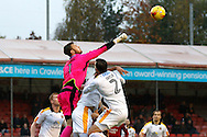Cambridge United goalkeeper Will Norris (1) jumps high to punch the ball clear during the EFL Sky Bet League 2 match between Crawley Town and Cambridge United at the Checkatrade.com Stadium, Crawley, England on 12 November 2016. Photo by Andy Walter.