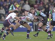 Twickenham, England, The Stoop, Surrey.<br /> 25/10/2003 - Photo  Peter Spurrier<br /> 2003_04 Zurich Premiership Rugby - Harlequins v Sale Sharks<br /> Quins  Mel Deane, tackles a charging Alex Sanderson.