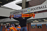 A man sells matchday merchandise outside Villa Park ahead of the match. Barclays Premier league match, Aston Villa v Arsenal at Villa Park in Birmingham on Saturday 20th Sept 2014<br /> pic by Mark Hawkins, Andrew Orchard sports photography.