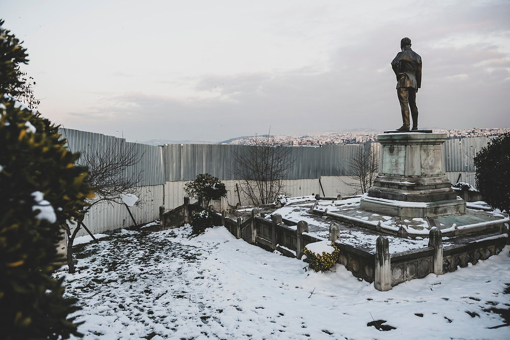 Istanbul, Turkey - January 9, 2013: A statue of modern Turkey's founder, Mustafa Kemal Atatürk, looks out over a fence across the Bosphorus Strait to the Asian side of the city.