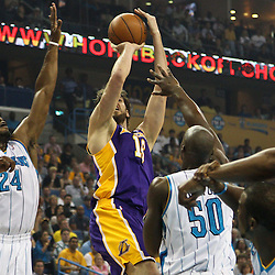 April 24, 2011; New Orleans, LA, USA; Los Angeles Lakers power forward Pau Gasol (16) shoots over New Orleans Hornets power forward Carl Landry (24) and center Emeka Okafor (50) during the first quarter in game four of the first round of the 2011 NBA playoffs at the New Orleans Arena.    Mandatory Credit: Derick E. Hingle