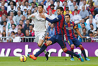 Real Madrid´s Cristiano Ronaldo (L) and Barcelona´s Pique during La Liga match between Real Madrid and F.C. Barcelona in Santiago Bernabeu stadium in Madrid, Spain. October 25, 2014. (ALTERPHOTOS/Victor Blanco)
