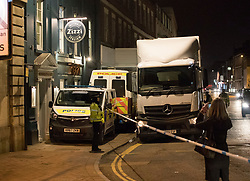 © Licensed to London News Pictures. 06/03/2018. Salisbury, UK. Police use a Tesco delivery truck to block the front entrance of the Zizzi restaurant as they search inside in protective suits and gas masks after former Russian spy Sergei Skripal and his daughter were taken ill with suspected poisoning. The couple where found unconscious on bench in Salisbury shopping centre. Specialist units have been called in to deal with any possible contamination. Photo credit: Peter Macdiarmid/LNP