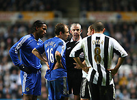 Photo: Andrew Unwin.<br /> Newcastle United v Chelsea. Carling Cup. 20/12/2006.<br /> The referee, Chris Foy, (C) has words with Chelsea's Didier Drogba (L) and Arjen Robben (#16).