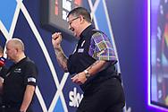 Gary Anderson celebrates winning the set during the William Hill World Darts Championship Semi-Finals at Alexandra Palace, London, United Kingdom on 2 January 2021.
