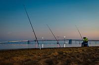 Long exposure of a fisherman and the Chesapeake Bay Bridge, near Annapolis, Maryland