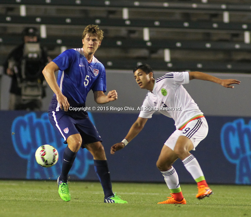 United States' Walker Zimmerman #5 and Mexico's §ngel Zaldivar #9 fight for a ball during a men's national team international friendly match, April 22, 2015, at StubHub Center in Carson, California. United States won 3-0. (Photo by Ringo Chiu/PHOTOFORMULA.com)
