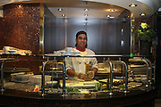 Asian Restaurant Chef prepares sushi