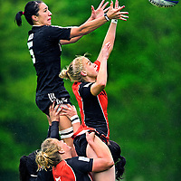 The Netherlands, Amsterdam, 17-05-2013.<br /> Rugby sevens, Women.<br /> IRB Woman Sevens World Series.<br /> The Netherlands vs New Zealand.<br /> Inge Visser (nr. 3) player from the netherlands is lifting Joyce van Altena up to the sky but van Altena cannot prevent that Sarah Goss who is playing for New Zealand catches the ball at a throw-in<br /> Photo : Klaas Jan van der Weij