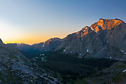 High angle view of sunrise looking eastward down th North Fork of the Popo Agie River,  from just below Texas Pass on Skunk Knob in the Wind River Range, mountains in the Shoshone National Forest, Fremont County, Wyoming, USA.