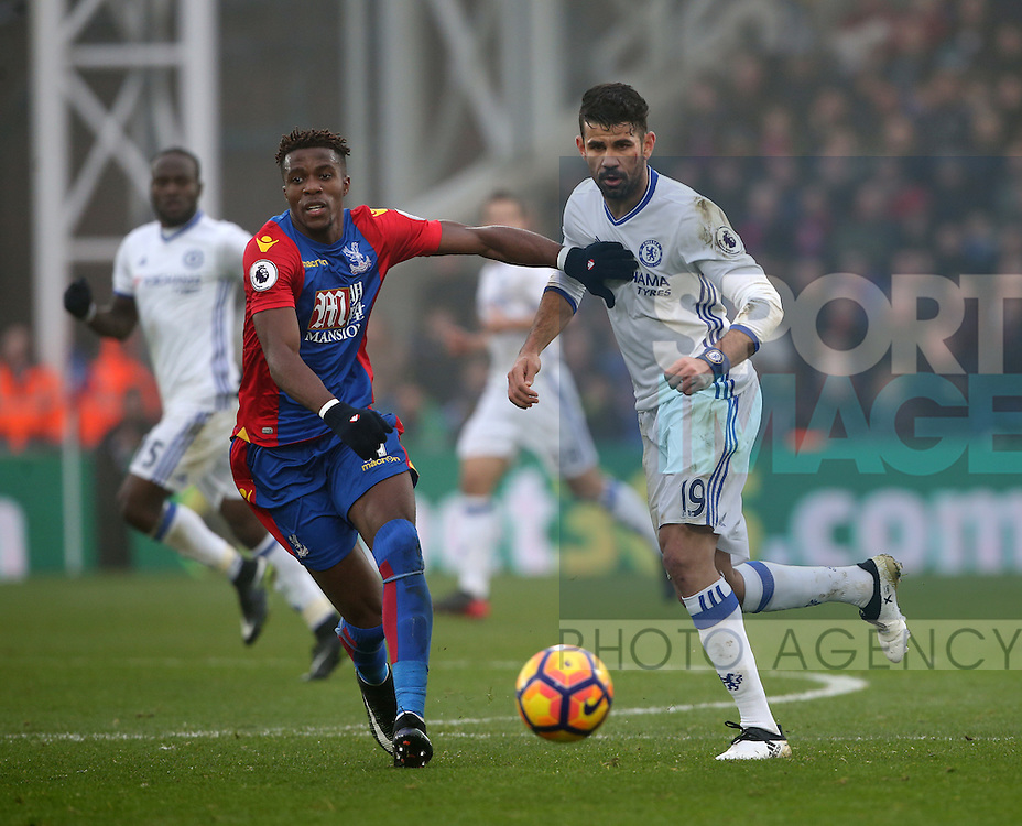 Crystal Palace's Wilfred Zaha tussles with Chelsea's Diego Costa during the Premier League match at Selhurst Park Stadium, London. Picture date December 17th, 2016 Pic David Klein/Sportimage