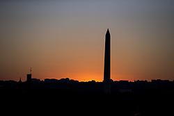 October 3, 2017 - Washington, District Of Columbia, USA - The Sun sets behind the Washington Monument on the National Mall in Washington, D.C. (Credit Image: © Alex Edelman via ZUMA Wire)