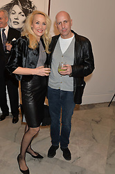 JERRY HALL and ARMAND LEROI at a private view of photographs by David Bailey entitled 'Bailey's Stardust' at the National Portrait Gallery, St.Martin's Place, London on 3rd February 2014.
