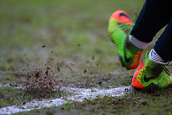 6 January 2018 -  The FA Cup - 3rd Round - Coventry City v Stoke City - Mud flies from the studs of a luminous pair of Nike boots - Photo: Marc Atkins/Offside