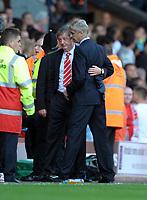 Roy Hodgson Manager puts his arm Arsene Wenger Manager Arsenal at Half Time after Joe Cole Sending Off<br /> Liverpool 2010/11<br /> Liverpool V Arsenal 15/08/10<br /> The Premier League<br /> Photo Robin Parker Fotosports InternationalTest
