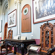 Smithsonian Castle West Range Exhibit. Some of the exhibit showing the Smithsonian's history on display in the West Range of the Smithsonian Castle. Formally known as the Smithsonian Institution Building, the Smithsonian Castle houses the administrative headquarters fo the Smithsonian Institution as well as some a permanent exhibition titled Smithsonian Institution: America's Treasure Chest. It's distinctive architectural style stands out on the southern side of the National Mall in Washington DC.